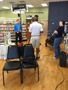 Jason Wang, pharmacist and owner of the Pevely Medicine Shoppe, being interviewed for the series of commercials for his shop.